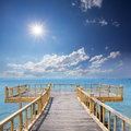 Wooden platform beside beach Royalty Free Stock Photography