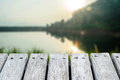 Wooden platform with river mountains and sunrise blurred Royalty Free Stock Photo
