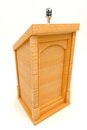 Wooden Podium with Microphone Stock Photography