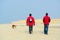 Wooden pole beach texel in front of walking people at dutch in slufter Stock Image