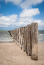 Wooden poles in the beach in pas de calais france strait of dover or is strait at narrowest part of english channel marking Stock Photo