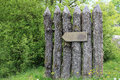 Wooden poles with blank directional sign Royalty Free Stock Photo