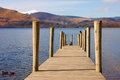 Wooden pontoon lake surrounded mountains Royalty Free Stock Photography