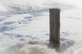 Wooden Post In The Snow