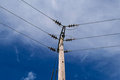 Wooden Power Electricity Pole Pylon,High Volage,Blue Sky Background Royalty Free Stock Photo