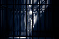 Wooden puppets in prison box Royalty Free Stock Image