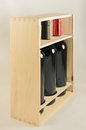 Wooden rack with three wine bottles Royalty Free Stock Photo