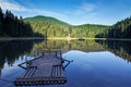 Wooden raft on the lake Synevyr. Stock Photography