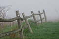 Wooden Rail Fence on a Foggy Spring Morning Royalty Free Stock Photo