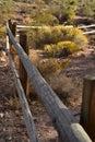 Wooden rail fence in desert landscape Royalty Free Stock Photo