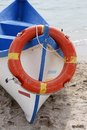 Wooden rescue boat with lifebuoy Royalty Free Stock Photos