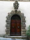 Wooden residential doorway in tuscany italy Royalty Free Stock Photo
