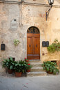 Wooden residential doorway in tuscany italy Royalty Free Stock Images