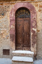 Wooden residential doorway in tuscany italy Royalty Free Stock Image