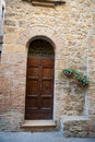 Wooden residential doorway in tuscany italy Royalty Free Stock Photos