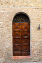 Wooden residential doorway in tuscany italy Stock Photos