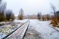 Wooden road bridge through frozen lake Royalty Free Stock Images