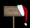 Wooden road sign with Santa  hat Stock Photos