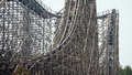 Wooden roller coaster with a steep drop Royalty Free Stock Photo