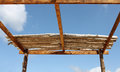 Wooden roof in progress frame under construction against blue sky Royalty Free Stock Images