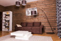Wooden room interior with couch and table