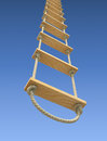 Wooden rope ladder on a gradient blue sky background Stock Photos