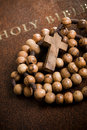 Wooden rosary on the Bible Royalty Free Stock Image