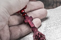 Wooden rosary and a Christian cross in his hand Royalty Free Stock Photo