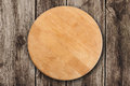 Wooden round board for pizza Royalty Free Stock Photo