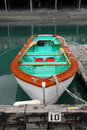 Wooden rowboat docked at a pier Royalty Free Stock Images