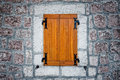 Wooden rustic antique window and stone wall Royalty Free Stock Image
