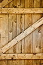 Wooden rustic barn door detail. Royalty Free Stock Photo