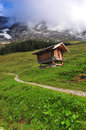 Wooden rustic house in switzerland Stock Images