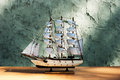 Wooden sail ship toy model on the table Royalty Free Stock Images