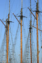 Wooden sailboat mast on blue sky background Royalty Free Stock Photos