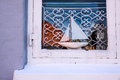Wooden sailing ship in the window of a house svaneke on bornholm denmark Royalty Free Stock Image