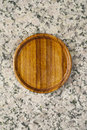 wooden saucer on granite stone Royalty Free Stock Photo