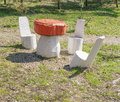 Wooden sculpture of table-mushroom and chairs Royalty Free Stock Photo