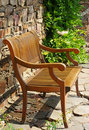 Wooden seat or bench on patio Royalty Free Stock Photography