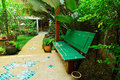 Wooden seat on platform among floral garden if you like to be with nature this style of is best Stock Images