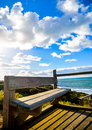 Wooden seat with sea and blue sky Stock Image