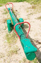 Wooden seesaw painted in green Royalty Free Stock Image