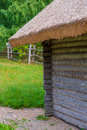 Wooden shed in the countryside thatched roof Royalty Free Stock Image