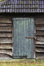 Wooden shed door an old with a rusty hinge Stock Photography