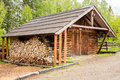 Wooden shed and logs prepared somewhere in forest Stock Images
