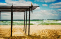 Wooden shelter on the beach near the sea under cloudy sky Royalty Free Stock Photos