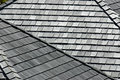 Wooden shingles several angled rooftops with worn and weathered Royalty Free Stock Photos
