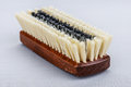 Wooden shoe brush lying on gray napkin Royalty Free Stock Photos
