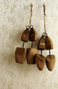 Wooden shoe stretcher mens and ladies still life Royalty Free Stock Photo