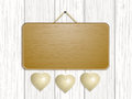 Wooden sign with hanging hearts Royalty Free Stock Photo